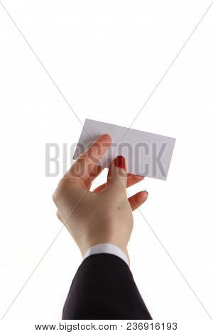 Female Hand Holding Business Card In Office.