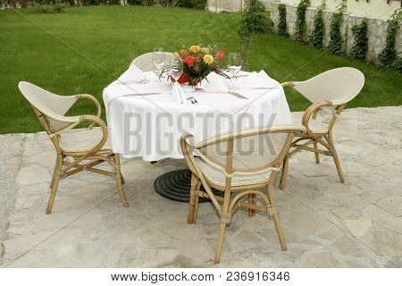 White Table Setting In Garden, Wealthy, Glasses