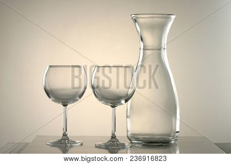 Two Glasses Of Wine And One Jug.