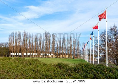 Gdansk Westerplatte, Poland - April 15, 2018: Masts With Flags And Inscription War Never Again (poli