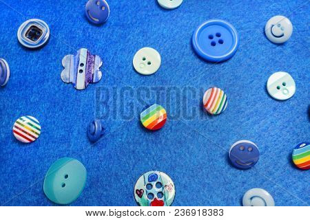 Bright buttons on a blue background. Fashion button.