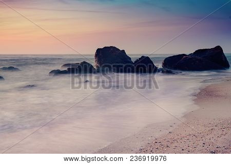 Summer Seasonal Natural Vacation Background. Romantic Morning At Sea. Big Boulders Sticking Out From