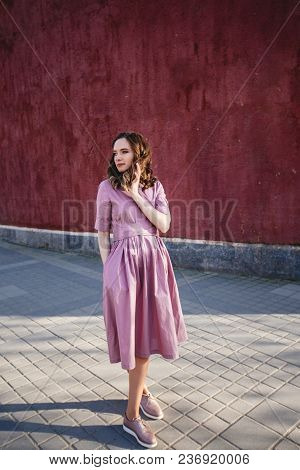 Beautiful Girl In The City In A Lilac Dress.