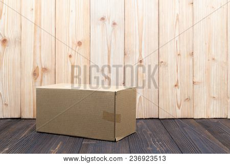 Empty Package Brown Cardboard Box Or Tray On Wooden Background, Mock Up.