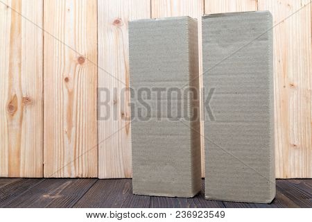 Empty Package Brown Cardboard Box Or Tray On Wooden Background, Mock Up For Long Item.