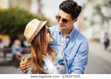 Smiling Couple In Love Outdoors.young Couple Hugging On The City Street.
