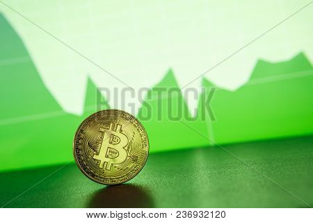 Bitcoin Gold Coin On The Background Of The Graph Of The Monitor. Business Concept