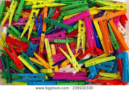 Colored Plastic Clothespins, A Colorful Background For Creativity