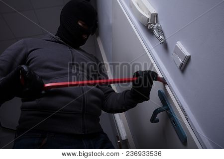 Thief Trying To Break The Door With Crowbar