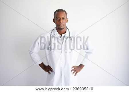 Serious Handsome Young Black Male Doctor. Medicine Concept. Isolated Front View On White Background.