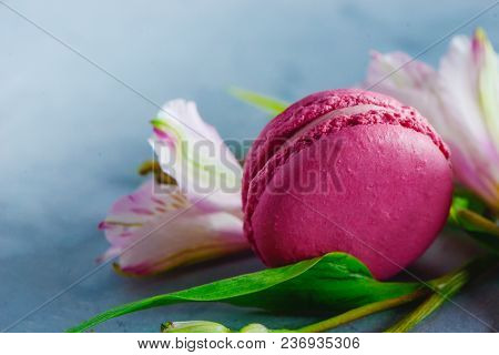 Pink Macaroon Close-up. Romantic French Dessert Decorated With Pink And White Alstroemeria Flowers O