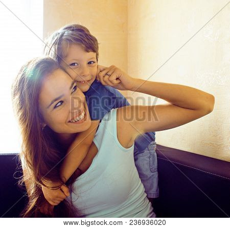 Mother With Son, Happy Family At Home Hugging