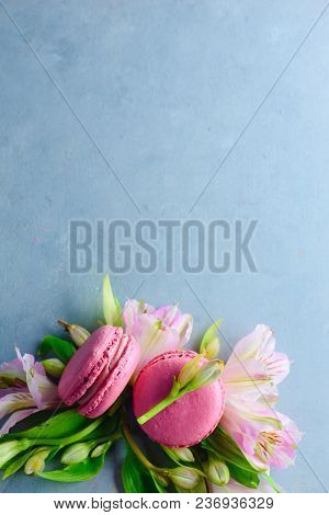 Macaroon Cookies Flat Lay With Spring Blossom On A Blue Stone Background With Copy Space. French Des