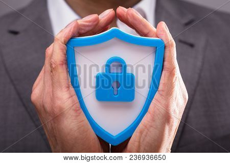 Businessperson Holding Shield Security Icon