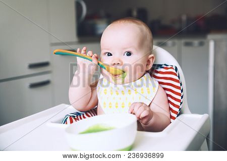 Feeding. Baby's First Solid Food
