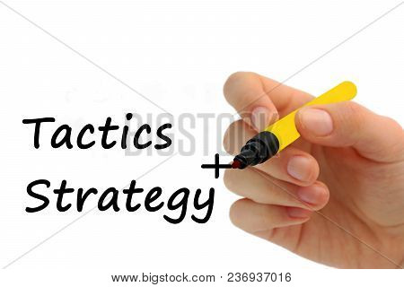 Hand Writing Strategy Plus Tactics On Transparent Wipe Board Business Concept,copy Space For Texture