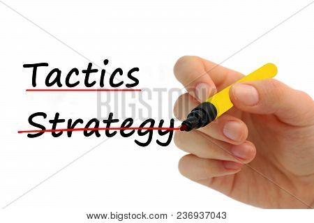 Hand Writing Strategy And Tactics With Red Marker On Transparent Wipe Board Business Concept,strateg
