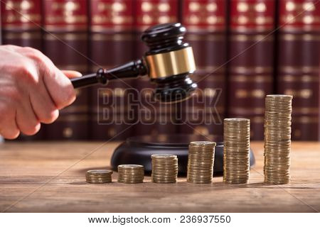 Close-up Of A Judge's Hand Holding Gavel