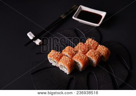 Philadelphia Maki Sushi On Black Background And Chop Sticks