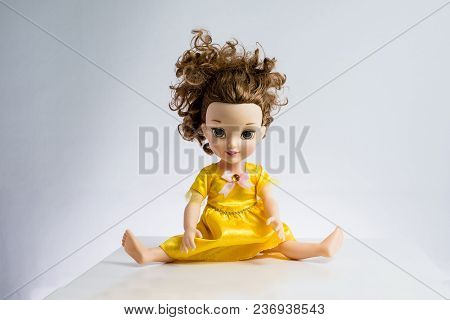Used Pretty Doll With Messed Up Hair In Pretty Dress Again White Backdrop, Legs Wide Open.