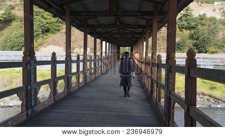 Covered Bridge With Man Walking. Thimpu. Kingdom Of Bhutan. Asia