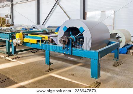 Industrial Metal Sheet Coil In Metal Sheet Profile Forming Machine In Workshop.