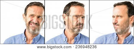 Middle age handsome man closeup doubt expression, confuse and wonder concept, uncertain future