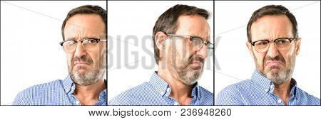 Middle age handsome man closeup having skeptical and dissatisfied look expressing Distrust, skepticism and doubt