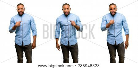 African american man with beard happy and surprised cheering expressing wow gesture, pointing with finger