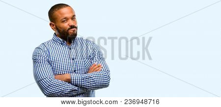 African american man with beard irritated and angry expressing negative emotion, annoyed with someone isolated over blue background