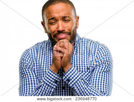 African american man with beard crying depressed full of sadness expressing sad emotion isolated over white background