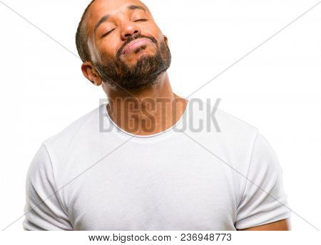 African american man with beard with sleepy expression, being overworked and tired isolated over white background