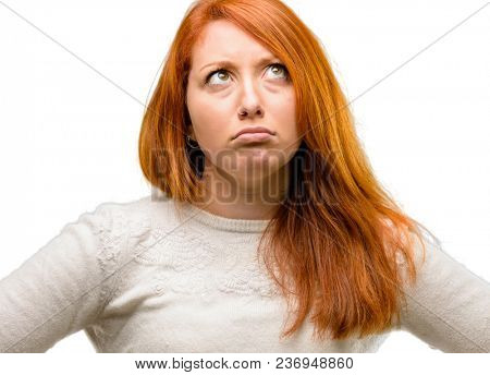 Beautiful young redhead woman doubt expression, confuse and wonder concept, uncertain future isolated over white background
