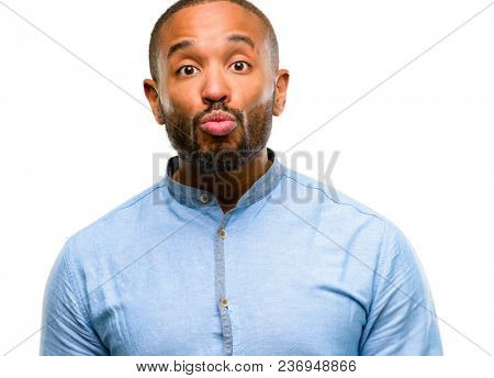 African american man with beard expressing love, blows kiss at camera, flirting isolated over white background