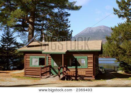 Cabin On Mountain Lake