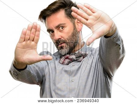 Middle age man, with beard and bow tie confident and happy showing hands to camera, composing and framing gesture isolated over white background