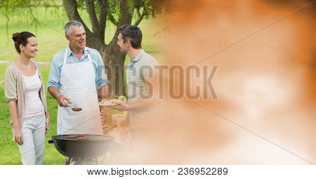Family talking around bbq with blurry orange transition
