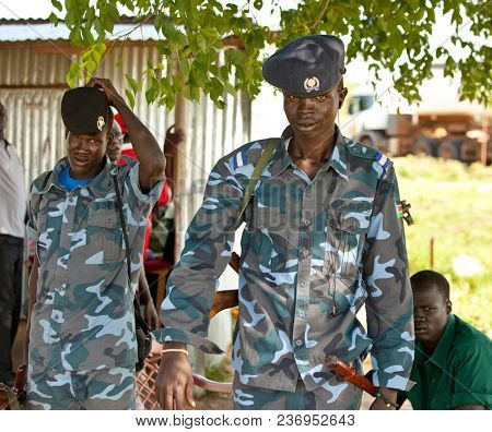 BOR, SOUTH SUDAN-JUNE 25, 2012: Two South Sudanese police man a military checkpoint north of Bor, South Sudan.
