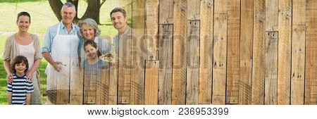 Family smiling at bbq with wood panel transition