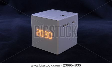 White Square Electronic Watch On A Dark Background With Texture, At 20:30