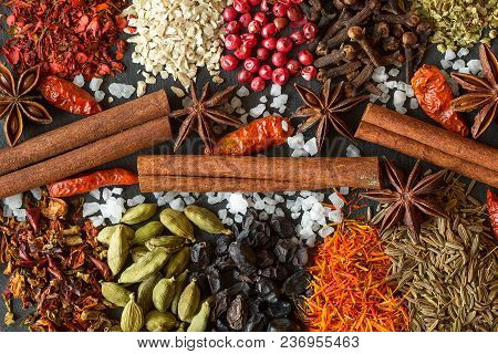 Aromatic Indian Spices On A Gray Slate  Background. Herb And Spice Ingredients On  Slate. Top View.