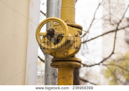 An Old Rusty Gas Control Valve. Industrial Valve In A Large System. Rusty Pipes.