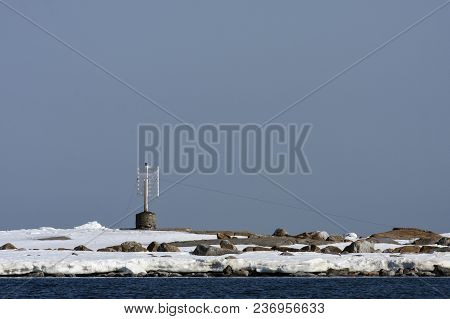 Coast, Coastline And Islands Of The Baltic Sea In April. Sunny Day, Navigation Mark On An Island.