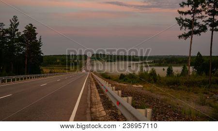 Landscape Of Asphalt Road On The Sunset