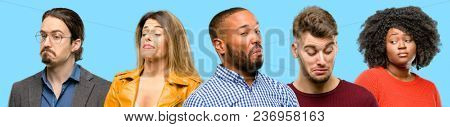 Group of mixed people, women and men having skeptical and dissatisfied look expressing Distrust, skepticism and doubt