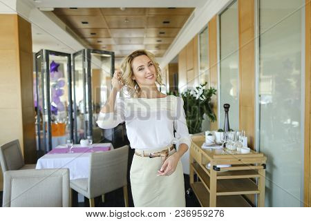 Charming Female Manager Standing At Restaurant. Concept Of Administration Job And Catering Establish
