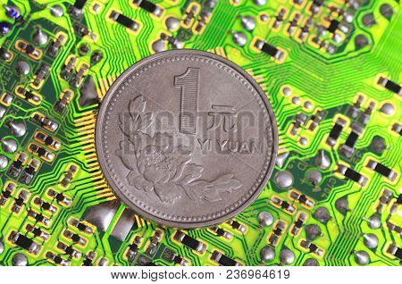 Chinese Yuan Coin On Printed Circuit Board.
