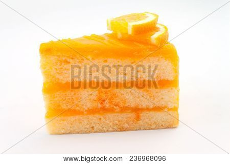 Piece Of Orange Cake Isolated On White Background
