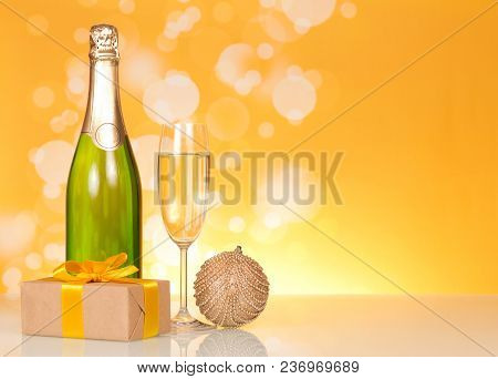 Bottle Of Champagne, Glass Of Wine, Christmas Toys And Gift, On Bright Yellow Background