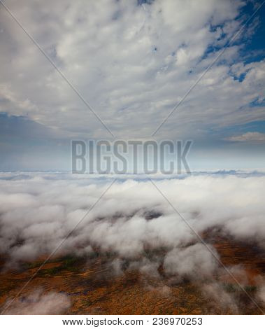 View From Above During Flight Between The White Clouds